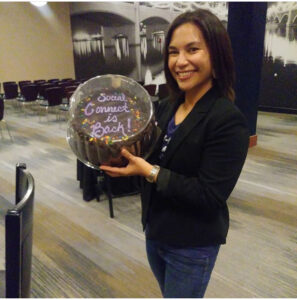 Tisha Pelletier holding chocolate cake at Social Connect PHX